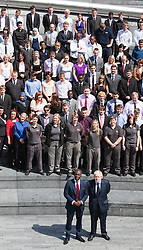 © licensed to London News Pictures. London, UK  05/07/2011. Apprenticeship Ambassador Tim Campbell and London Mayor Boris Johnson in front of apprentices on the steps of The Scoop. Mayor of London Boris Johnson was joined by more than 150 apprentices and employers to celebrate beating his target of creating 20,000 apprenticeship opportunities in the capital. Working in partnership with the National Apprenticeship Service (NAS), the Mayor's campaign has seen a total of 28,120 people finding places on schemes with companies across a wide range of the capital's business sectors. The 20,000 target has been smashed three months early and by almost 50 per cent. Please see special instructions for usage rates. Photo credit should read Bettina Strenske/LNP
