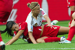 26.06.2011, Olympiastadion Berlin, Berlin, GER, FIFA Women's Worldcup 2011, Gruppe A,  Deutschland (GER) vs. Canada (CAN), im Bild 2 Emily ZURRER Alexnadra Popp (GER11 #11, Duisburg)am Boden // during the FIFA Women's Worldcup 2011, Pool A, Germany vs Canada on 2011/06/26, Olympiastadion, Berlin, Germany.   EXPA Pictures © 2011, PhotoCredit: EXPA/ nph/  Kokenge       ****** out of GER / SWE / CRO  / BEL ******