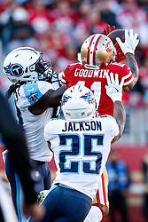 SANTA CLARA, CA - DECEMBER 17: Wide receiver Marquise Goodwin #11 of the San Francisco 49ers catches a pass in front of cornerback Adoree' Jackson #25 of the Tennessee Titans and Erik Walden #93 during the second quarter at Levi's Stadium on December 17, 2017 in Santa Clara, California.  (Photo by Jason O. Watson/Getty Images) *** Local Caption *** Marquise Goodwin; Adoree' Jackson; Erik Walden