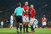 Wayne Rooney Forward of Manchester United with blood on his face argues with Referee Michael Jones during the EFL Cup Quater-Final between Manchester United and West Ham United at Old Trafford, Manchester, England on 30 November 2016. Photo by Phil Duncan.