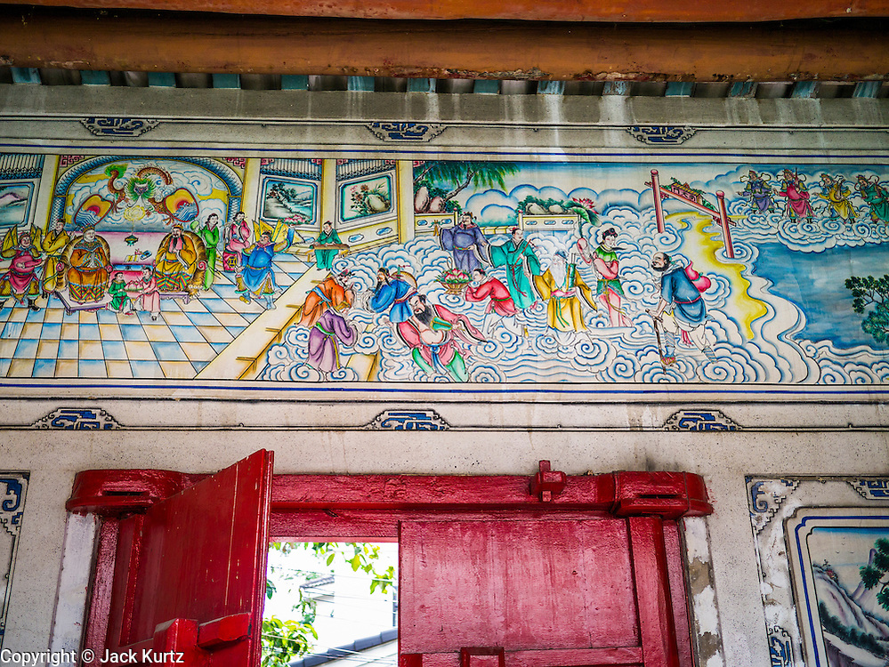 20 APRIL 2013 - BANGKOK, THAILAND:   The artwork above the front door of the home of an old family of Chinese traders in Talat Noi (Talat means Market, Noi means Small. Literally Small Market). The Talat Noi neighborhood in Bangkok started as a blacksmith's quarter. As cars and buses replaced horse and buggy, the blacksmiths became mechanics and now the area is lined with car mechanics' shops. It is one the last neighborhoods in Bangkok that still has some original shophouses and pre World War II architecture. It is also home to a  Teo Chew Chinese emigrant community.   PHOTO BY JACK KURTZ