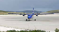 Barra Airport is a short-runway airport situated in the wide shallow bay of Traigh Mhòr at the north tip of the island of Barra in the Outer Hebrides, Scotland. Barra is now the only beach airport anywhere in the world to be used for scheduled airline services. Loganair Twin Otter taxiing towards terminal building. (c) Stephen Lawson | Edinburgh Elite media