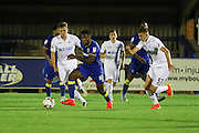 AFC Wimbledon striker Dominic Poleon (10) and Swansea City U23 defender and captain Keston Davies (57) during the EFL Trophy match between AFC Wimbledon and U23 Swansea City at the Cherry Red Records Stadium, Kingston, England on 30 August 2016. Photo by Stuart Butcher.