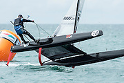 Tim Willets (NZL257) rounding the top mark in race five of the A Class World championships regatta being sailed at Takapuna in Auckland. 13/2/2014