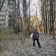 Valentina returned to her house in Pripyat 29 years after the Chernobyl's accident. Nature has taken over the city and trees are growing in the streets.