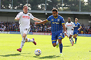Andy Barcham of AFC Wimbledon and Gill Swerts battle during the Sky Bet League 2 match between AFC Wimbledon and Notts County at the Cherry Red Records Stadium, Kingston, England on 19 September 2015. Photo by Stuart Butcher.