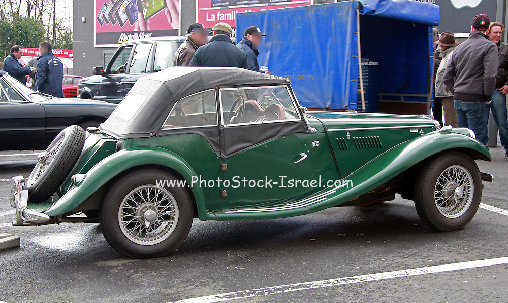 Green MGA sports car side view