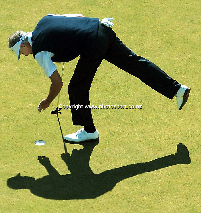 Sir Bob Charles retrieves his ball on day three of Telstra Saturn New Zealand Golf Open, 20 January, 2001 at The Grange, Papatoetoe. Photo:Dean Treml/PHOTOSPORT *** Local Caption ***