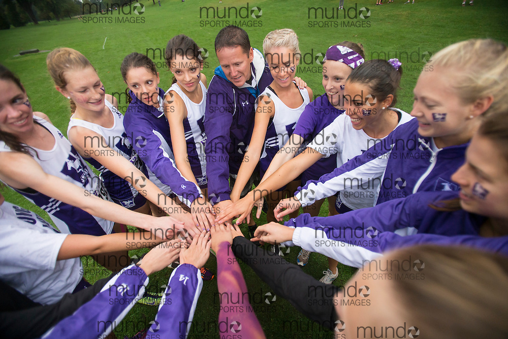 The Western Mustangs women's team huddle up before their 5K run at the 2013 Western International Cross country meet in London Ontario, Saturday,  September 21, 2013.<br /> Mundo Sport Images/ Geoff Robins