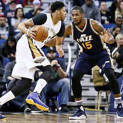 Feb 10, 2016; New Orleans, LA, USA; New Orleans Pelicans forward Anthony Davis (23) drives past Utah Jazz forward Derrick Favors (15) during the second half of a game at the Smoothie King Center. The Pelicans defeated the Jazz 100-96. Mandatory Credit: Derick E. Hingle-USA TODAY Sports