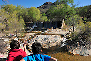 Water flows at Sabino Dam in Sabino Creek, Santa Catalina Mountains, Coronado National Forest, Sonoran Desert, Tucson, Arizona, USA.