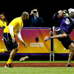 Jan 31, 2013; New Orleans, LA, USA; NFC squad Deion Sanders catches a touchdown and loses a shoe as AFC squad Torry Holt defends during the Tazon Latino VII flag football game at Clinic Field  inside the Ernest Morial Convention center. Super Bowl XLVII will take place between the San Francisco 49ers and the Baltimore Ravens on February 3, 2013 at the Mercedes-Benz Superdome.  Mandatory Credit: Derick E. Hingle-USA TODAY Sports