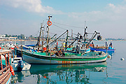 Fishing boats, at the ancient harbour in old Akko<br /> Akko also Acre, is a city in northern Israel with a history spanning centuries. It also played a major role in the holy land crusades