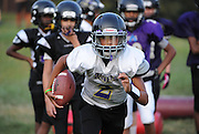 7/30/14 7:35:22 PM -- Columbia, MD  -- Football player Jared Morson, 13, carries the ball during a drill at practice.   Photo by H. Darr Beiser, USA TODAY Staff ORG XMIT:  HB 131444 CONCUSSION 07/30/2014 (Via OlyDrop)