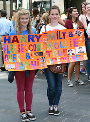 One Direction fans Mollie Brown and Emily Barnet  queueing in Leicester Square in London for the world premiere of band's film One Direction: This Is Us,Tuesday, 20th August 2013. Picture by Stephen Lock / i-Images