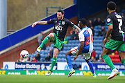 Blackburn Rovers Hope Akpan and Bristol City striker, Lee Tomlin (9) battle during the Sky Bet Championship match between Blackburn Rovers and Bristol City at Ewood Park, Blackburn, England on 23 April 2016. Photo by Pete Burns.