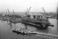 Waverley paddle steamer passes a ship launch at Kvaerner shipbuilding yard, on the River Clyde, Glasgow, Scotland, June 1993.