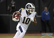 Sep 10, 2018; Oakland, CA, USA; Los Angeles Rams wide receiver Pharoh Cooper (10)\ carries the ball against the Oakland Raiders at the Oakland-Alameda County Coliseum. The Rams defeated the Raiders 33-13.