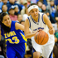 030113  Adron Gardner/Independent<br /> <br /> Zuni Thunderbird Alissa Paquin (23) attempts a steal on Navajo Pine Warrior Demetria Clichee (23) during the 1-2A district final in Navajo Friday.