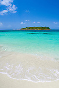 Blue Beach. Blue sky, turquoise water and white sandy beach