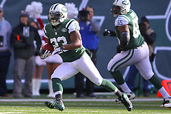 Dec 23, 2012; East Rutherford, NJ, USA; New York Jets running back Shonn Greene (23) runs with the ball during the first half of their game against the San Diego Chargers at MetLIfe Stadium.