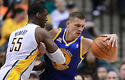 Feb. 28, 2012; Indianapolis, IN, USA; Golden State Warriors center Andris Biedrins (15) and Indiana Pacers center Roy Hibbert (55) get tied up at Bankers Life Fieldhouse. Mandatory credit: Michael Hickey-US PRESSWIRE