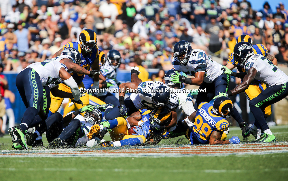 Los Angeles Rams running back Todd Gurley (30) with the ball is defended by Seattle Seahawks during a NFL football game, Sunday, Sept. 18, 2016, in Los Angeles. The Rams won 9-3. (Photo by Ringo Chiu/PHOTOFORMULA.com)<br /> <br /> Usage Notes: This content is intended for editorial use only. For other uses, additional clearances may be required.