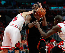 15.05.2011, UNITED CENTER, CHICAGO, USA, NBA, Chicago Bulls vs Miami Heat, im Bild Chris Bosh (C) is fouled by Chicago Bulls center Joakim Noah (L) in game 1 of the NBA Eastern Conference Championships at the United Center in Chicago, EXPA Pictures © 2011, PhotoCredit: EXPA/ Newspix/ KAMIL KRZACZYNSKI +++++ ATTENTION - FOR AUSTRIA/ AUT, SLOVENIA/ SLO, SERBIA/ SRB an CROATIA/ CRO, SWISS/ SUI and SWEDEN/ SWE CLIENT ONLY +++++