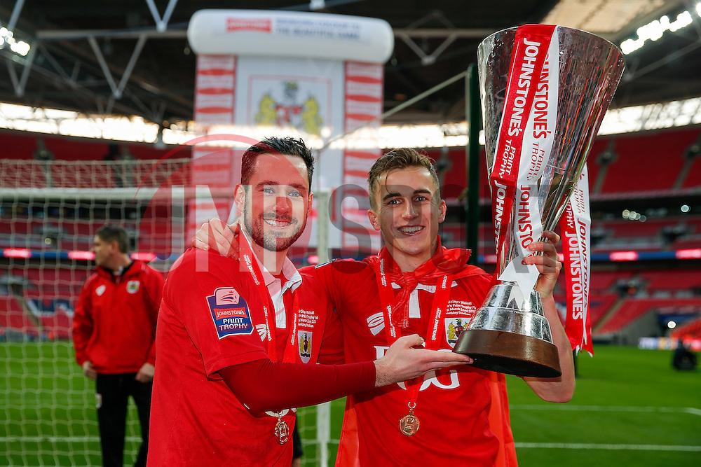 Greg Cunningham and Joe Bryan hold the Football League Trophy after Bristol City win the match 2-0 - Photo mandatory by-line: Rogan Thomson/JMP - 07966 386802 - 22/03/2015 - SPORT - FOOTBALL - London, England - Wembley Stadium - Bristol City v Walsall - Johnstone's Paint Trophy Final.