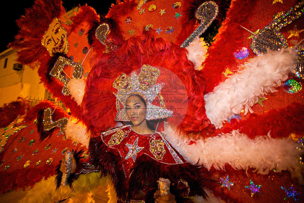 A costumed beauty queen dances in the streets during the Carnaval de Ponce February 21, 2009 in Ponce, Puerto Rico.