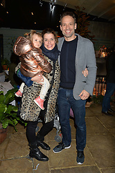 The Ivy Chelsea Garden's Guy Fawkes Party & Launch of The Winter Garden was held on 5th November 2016.<br /> Picture shows:- SABINE ROEMER, her husband ANDRAS SZIRTES and their daughter ROMY.