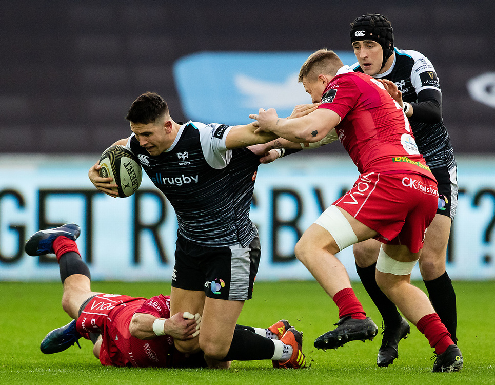Owen Watkin of Ospreys is tackled by Kieron Fonotia of Scarlets<br /> <br /> Photographer Simon King/Replay Images<br /> <br /> Guinness PRO14 Round 11 - Ospreys v Scarlets - Saturday 22nd December 2018 - Liberty Stadium - Swansea<br /> <br /> World Copyright © Replay Images . All rights reserved. info@replayimages.co.uk - http://replayimages.co.uk