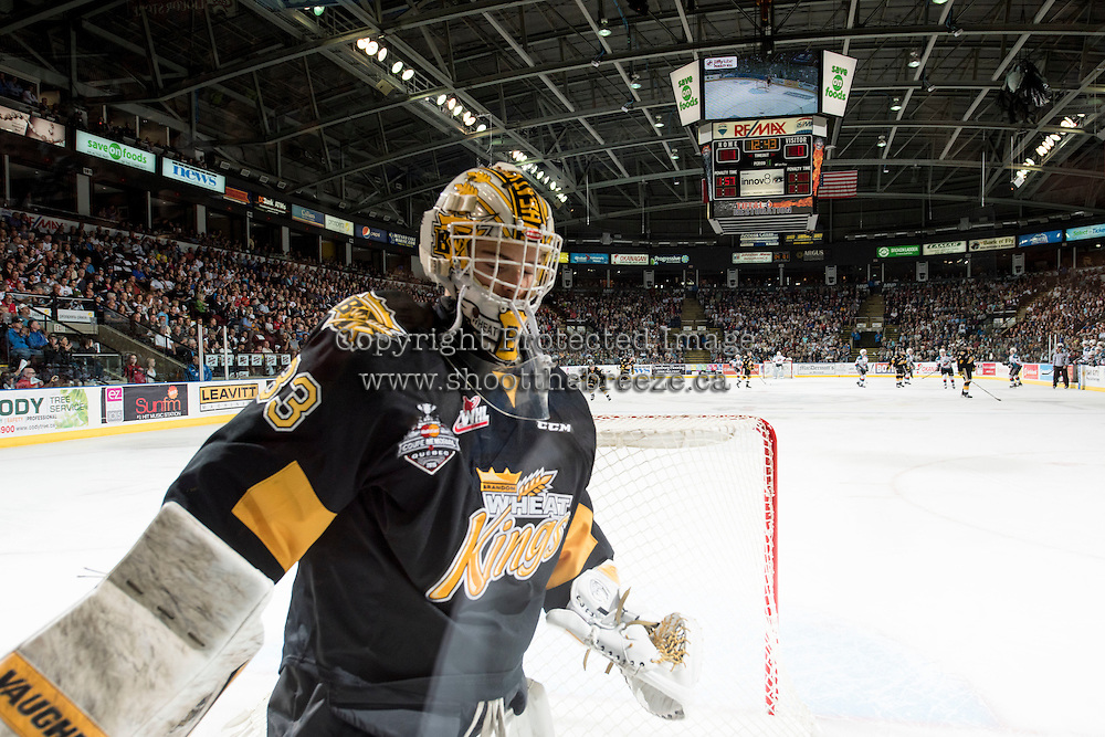 KELOWNA, CANADA - MAY 11: Jordan Papirny #33 of Brandon Wheat Kings skates behind the net against the Kelowna Rockets on May 11, 2015 during game 3 of the WHL final series at Prospera Place in Kelowna, British Columbia, Canada.  (Photo by Marissa Baecker/Shoot the Breeze)  *** Local Caption *** Jordan Papirny