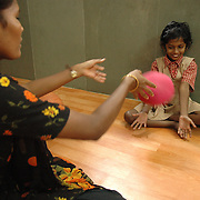 Ramani plays ball with a partially blind girl at the new Physiotherapy Unit at APD. According to APD, the physiotherapy practiced tries to reach people through grass-root staff and is a therapy that is easy to adapt and avoids complicated methods.