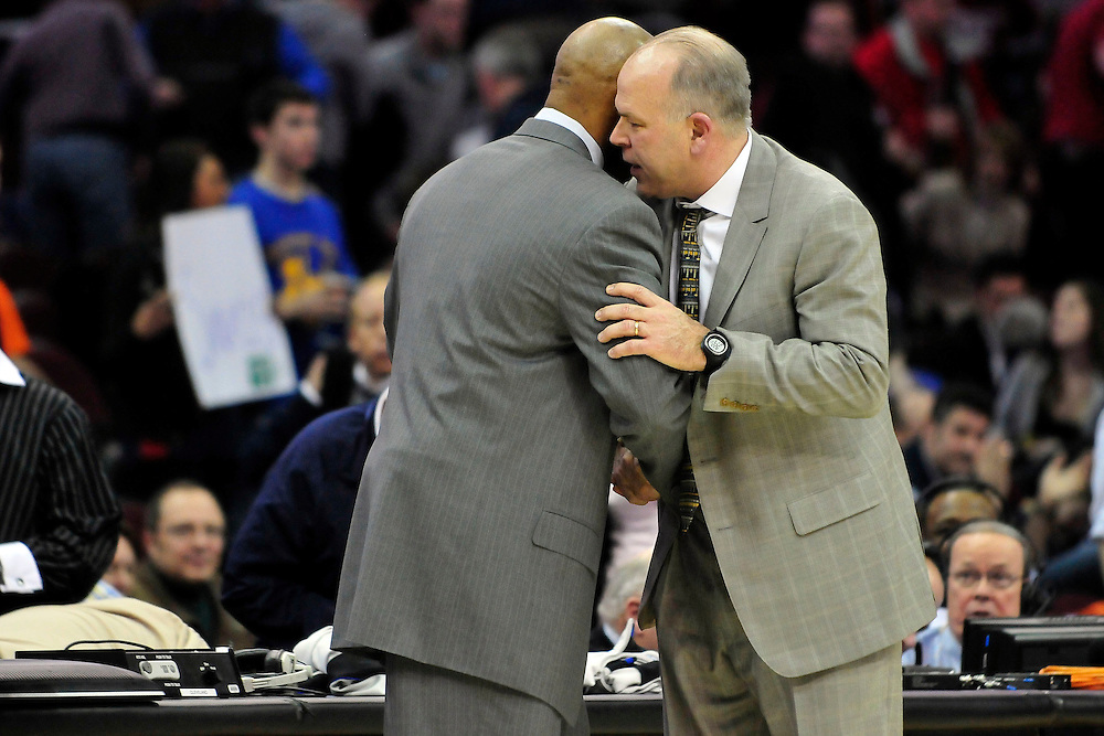 Feb. 9, 2011; Cleveland, OH, USA; Detroit Pistons head coach John Kuester, right, talks with Cleveland Cavaliers head coach Byron Scott after the Pistons beat the Cavaliers at Quicken Loans Arena. The Pistons beat the Cavaliers 103-94 for Cleveland's 26th loss in a row. Mandatory Credit: Jason Miller-US PRESSWIRE