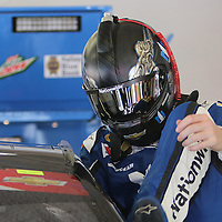 Sprint Cup Series driver Dale Earnhardt Jr. (88) enters his car in the garage area during the 57th Annual NASCAR Coke Zero 400 practice session at Daytona International Speedway on Friday, July 3, 2015 in Daytona Beach, Florida.  (AP Photo/Alex Menendez)