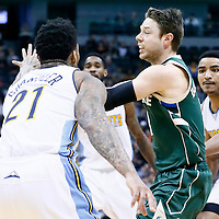 03 February 2016: Milwaukee Bucks guard Matthew Dellavedova (8) passes the ball past Denver Nuggets guard Gary Harris (14) and Denver Nuggets forward Wilson Chandler (21) during the Denver Nuggets 121-117 victory over the Milwaukee Bucks, at the Pepsi Center, Denver, Colorado, USA.