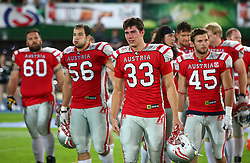 07.06.2014, Ernst Happel Stadion, Wien, AUT, American Football Europameisterschaft 2014, Finale, Oesterreich (AUT) vs Deutschland (GER), im Bild Roman Seybold, (Team Austria, OL, #60), Alexander Taheri, (Team Austria, DL, #56), Felix Stadler, (Team Austria, RB, #33) und Florian Probst, (Team Austria, LB, #45)a enttaeuscht nach der Niederlage // during the American Football European Championship 2014 final game between Austria and Denmark at the Ernst Happel Stadion, Vienna, Austria on 2014/06/07. EXPA Pictures © 2014, PhotoCredit: EXPA/ Thomas Haumer