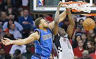 Jan 24, 2016; Houston, TX, USA;  Houston Rockets forward Clint Capela (15) dunks against Dallas Mavericks guard Justin Anderson (1) in the second half at Toyota Center. Rockets won 115 to 104. Mandatory Credit: Thomas B. Shea-USA TODAY Sports