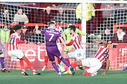 Jake Hessenthaler's shot is blocked Tyrone Barnett  during the EFL Sky Bet League 2 match between Cheltenham Town and Grimsby Town FC at LCI Rail Stadium, Cheltenham, England on 8 December 2018.