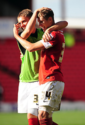Barnsley's John Stones celebrates with Barnsley's Danny Rose on the final whistle after seeing his side win 1- 0 - Photo mandatory by-line: Joe Meredith/Josephmeredith.com  - Tel: Mobile:07966 386802 01/09/2012 - Barnsley v Bristol City - SPORT - FOOTBALL - Championship -  Barnsley  - Oakwell Stadium -