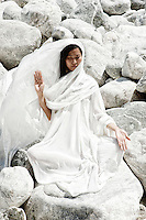 Archetypal asian woman meditating in the stones.<br /> ::::::::::::::::::::::::::::::::::::::::::::::::::::::::::::::::::::::<br /> &quot;I work a lot with metta, the Buddhist practice of cultivating compassion. I visualize people who are central to my life. As each person comes to mind I offer this blessing: May you be free from fear. May you be free from compulsion. May you be blessed with love. May you be blessed with peace. Reciting this reminds me that the hurtful things we do and say are often an expression of our fears and compulsions and are not freely chosen acts of harm. Knowing this allows me to have compassion for others and myself as well.&quot;<br /> -Rabbi Rami