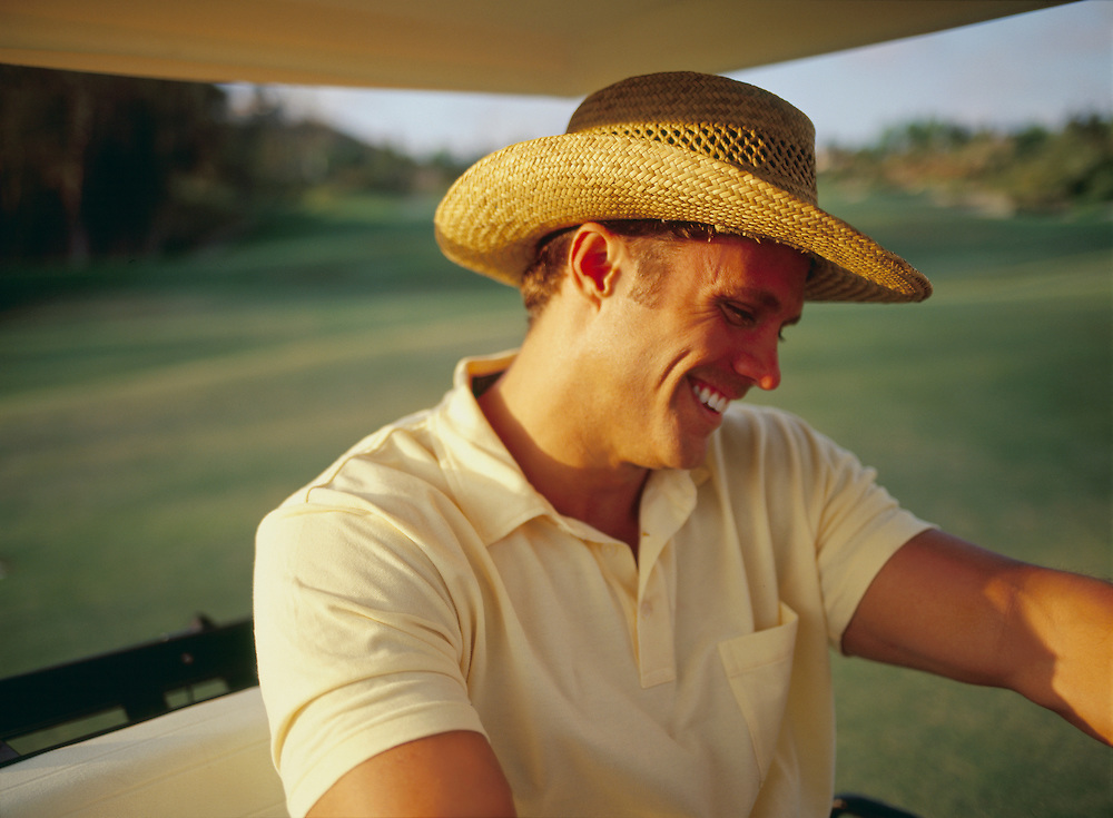 Golfer smiling in golf cart