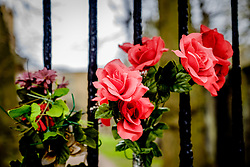 Flowers on the locked gates of the Covenanter's Prison in Grey Friars church yard in Edinburgh, Scotland<br /> <br /> (c) Andrew Wilson | Edinburgh Elite media