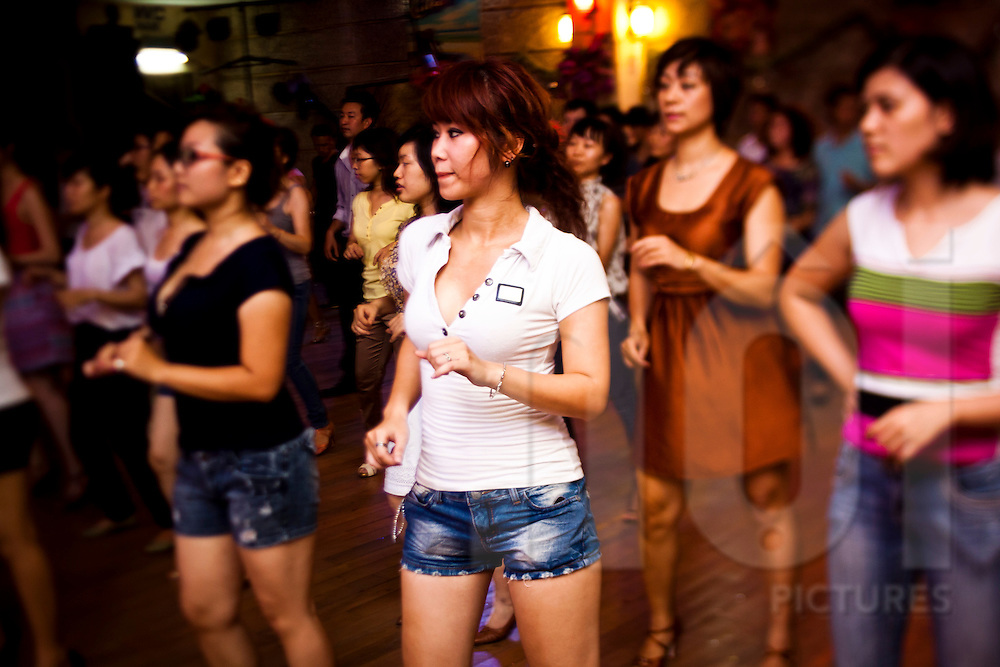 People participate in a salsa class in Hanoi, Vietnam