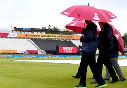 Officials check the outfield as rain delays the start of the Women's World Cup match between South Africa Women and New Zealand Women at Derby - Mandatory by-line: Robbie Stephenson/JMP - 28/06/2017 - CRICKET - County Ground - Derby, United Kingdom - South Africa Women v New Zealand Women - ICC Women's World Cup Match 6
