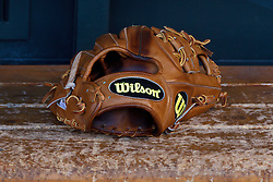 SAN FRANCISCO, CA - JUNE 07:  Detailed view of a Wllson baseball glove in the dugout before the game between the San Francisco Giants and the New York Mets at AT&T Park on June 7, 2014 in San Francisco, California.  The San Francisco Giants defeated the New York Mets 5-4. (Photo by Jason O. Watson/Getty Images) *** Local Caption ***