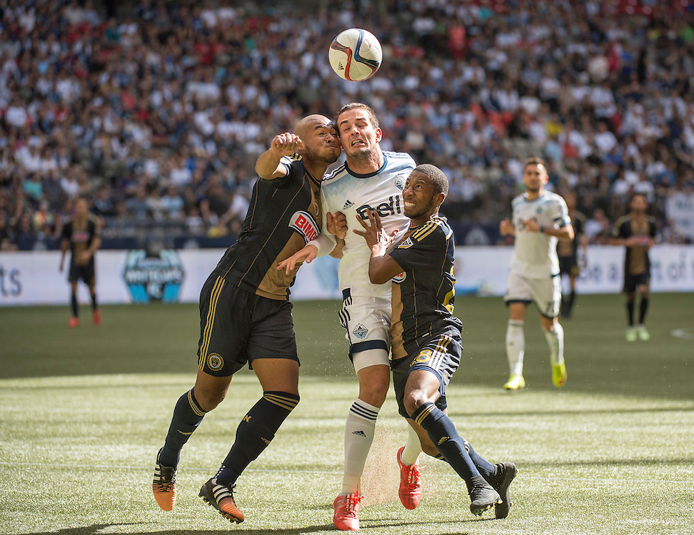MLS Soccer- Vancouver Whitecaps FC vs. Philadelphia Union at BC Place Stadium in Vancouver: Ethan Whiote (Left) of Philadelphia Union, Octavio Rivero Vancouver Whitecaps (middle) and Raymon Gaddis of the Philadelphia union.