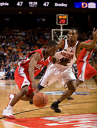 Bradley guard Daniel Ruffin (20) dribbles past Virginia guard Sean Singletary (44).  The Virginia Cavaliers fell to the Bradley Braves 96-85 in the semifinals of the 2008 College Basketball Invitational at the University of Virginia's John Paul Jones Arena in Charlottesville, VA on March 26, 2008.