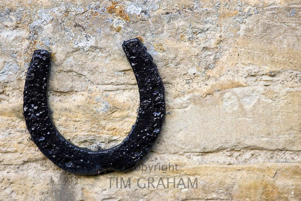 Horseshoe on a Cotswold stone wall farmhouse, Oxfordshire, United Kingdom